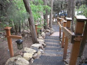 Steps going down to parking lot inside property of 10,000 waves resort and spa